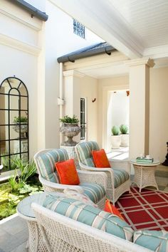 An outdoor area of a home of classic architectural proportions that overlooks Moreton Bay. #thomasandalexander #courtyard #colour #client #interior #interiors #interiordesign #interdecor #interdecoration #interiordecoration #decor #design #decoration #home #house #Queensland #Brisbane #alfresco #Australia #Sydney #Melbourne #classic #homedesign #homedecor #courtyard #outdoors #cushion #cushions #pool