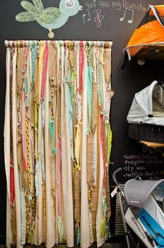 Curtains made from strips of burlap and various fabrics.  Backdrop idea..