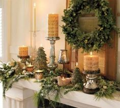 i like the colors and print of the candles pottery barn christmas christmas mantels - French Country Christmas Decor