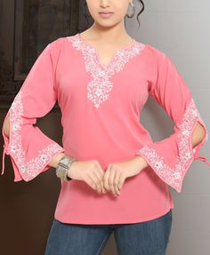 This Coral Designer Evening Top/Tunic/Kurti is made from a soft unsheer georgette fabric with embroidery & embellishment and designer styling. The exquisite embroidery/embellishment on this beautiful, trendy Tunic Kurti is unique, custom designed and don Evening Shawls And Wraps, Indian Tops, Cotton Tunic Tops, Indian Tunic, Evening Tops, Georgette Fabric, Wholesale Fashion, Fashion Dresses, Women's Fashion
