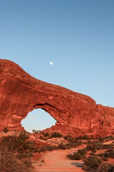 Sunset and moonrise at North Window in Arches National Park, Utah.
