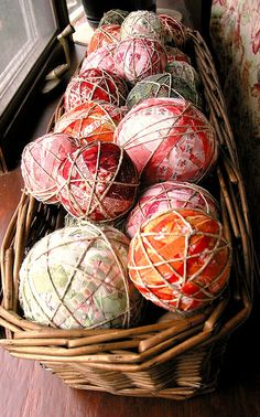 Fabric balls - love the twine over the fabric. The core of the balls could be styrofoam. I would wind enough fabric to make them squishy. Then add twine. Or maybe yarn.
