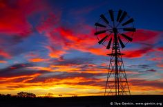 Windmill at Sunset in Australian Outback, Sturt National Park, New South Wales (NSW), Australia. Magnificent stock photo of the dramatic clouds highlighted by sunset over windmill in Australian Outback in Sturt National Park, NSW. By Ilya Genkin. Photography Tutorials, Color Photography, Landscape Photography, Travel Photography, Outback Australia, Australia Travel, Amazing Sunsets, Beautiful Sunset, Beautiful Places