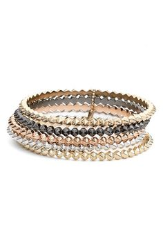 Free shipping and returns on Kendra Scott 'Remy' Stackable Bracelets (Set of 5) at Nordstrom.com. Rows of studs put a punk-rock twist on these perfectly stackable bracelets offered in a range of metallic tones that expertly mix and remix with other bangles.