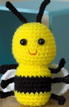 I found this baby bee pattern on RedHeart.com. I'm new at the whole crochet thing, but did a pretty good job. Instead of button eyes, I used yarn. And, I used pink yarn for the mouth since I didn't have any floss.  Turned out great!!