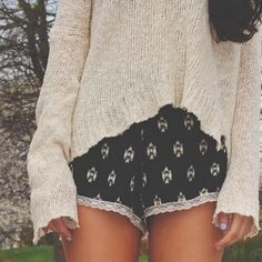 black and white shorts with a sweater