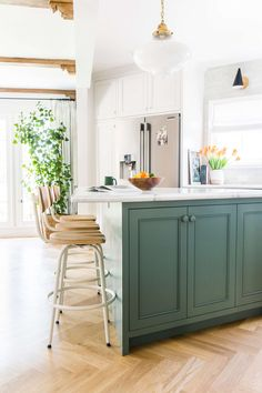 Kitchen islands. All types and sizes can be found here, painted island, stained wood island, marble topped island, kitchen island with legs, antique kitchen island, kitchen island as cabinetry, just beautiful, unique kitchen islands with nice details