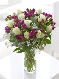 Fairtrade White Rose and Alstroemeria Hand-tied - Interflora