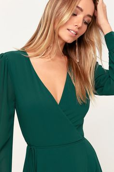 It's easy to be swept away by the romance of the Lulus My Whole Heart Emerald Green Long Sleeve Wrap Dress! Long sleeve wrap maxi dress with round button deets. Emerald Green Dress Long, Green Long Sleeve Dress, Green Gown, Long Sleeve Maxi, Maxi Dress With Sleeves, Emerald Bridesmaid Dresses, Emerald Green Dresses, Bridesmaids, Maxi Wrap Dress