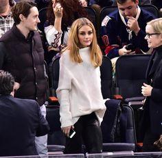 Olivia Palermo: off white oversized turtleneck sweater, leather pants