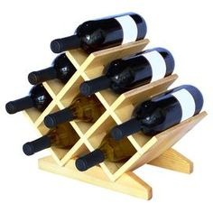 "Stow your favorite vintages and special-occasion bubbly in this 8-bottle pine wood wine rack, showcasing a beautiful crisscross design.  Product: Wine rackConstruction Material: PineColor: NaturalFeatures:  HandcraftedHolds eight bottles of wine Dimensions: 9"" H x 15"" W x 8"" D"