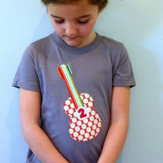 http://www.etsy.com/listing/69526224/rockin-guitar-birthday-t-shirt-toddler