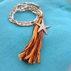 Long boho necklace with sea-shells and tassel - silver starfish
