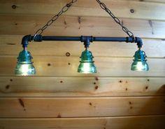 This one-of-a-kind, industrial chic hanging light is crafted from antique glass insulators -- which were first produced in the 1850s for use with