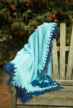 How-To: Make a No-Sew Blanket w. Yarn Fringe. this is really cute & its different than those tie blankets.