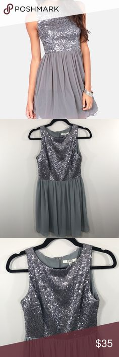 """BB Dakota Gray Holly Silver Sequin Dress In excellent used condition. Gray color. Sequin top with tulle fully lined skirt. Size 2, true to size. Please refer to proper measurements to ensure a proper fit! Across: 15"""" Length of sequins: 15"""" Length of Skirt: 19"""" Waist: 13"""" BB Dakota Dresses Mini"""