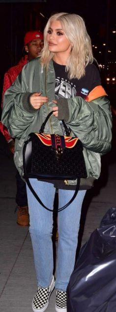 Kylie Jenner: Shirt – Raiders  Purse – Gucci  Jeans and jacket – Vetements  Shoes – Vans