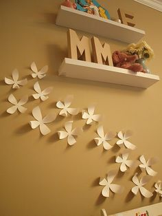 DIY flowers...I might do them out of gold cardstock over pink painted walls for Sam's new room