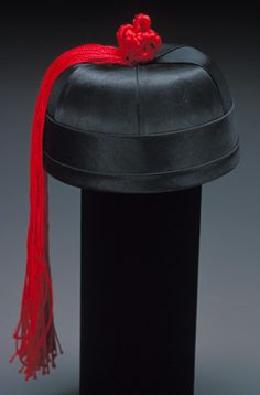 Wealthy Chinese boy's Hat, unknown artist,early 20th century.  Black silk satin and velvet, Chinese, 4-1/2 x 5-3/4 inches.  Murray Warner Collection of Oriental Art.