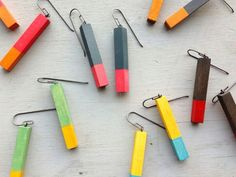 Just some of the colorways available in stacked earrings by Julia Turner. Made from reclaimed wood and oxidized sterling silver. Gallery Lulo.