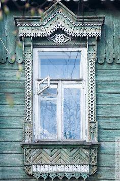 Notice the little tiny window within a window - cute idea!  //  My favorite window design. Vladimir, Russia