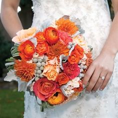 Beautiful-- exactly colorful yet subtle enough. The color palette is so pretty.http://www.theknot.com/weddings/photo/orange-and-gray-bridal-bouquet-127421