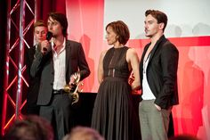 Jerôme Bonnell receiving his Golden Swann for Best Movie for Le Temps de l'Aventure from Kristin Scott Thomas and Jonathan Rhys Meyers.