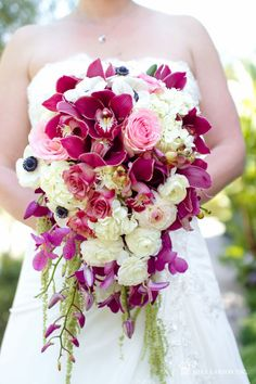 (Below Right) Created by April Flowers via Bollea, this bright and bold bouquet is one of our favourites with its rich magenta, pink and cream tones! Made from a combination of burgundy cymbidium orchids, purple dendrobium orchids, pink mokara orchids, pink tea roses, white anemones, white ranunculus, white hydrangea and pink ranunculus.