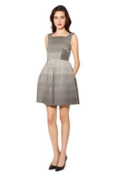 RAOUL LORI DRESS The Lori Dress is the ideal party dress. With a high neckline and full skirt, this dress has the perfect amount of flirtiness.