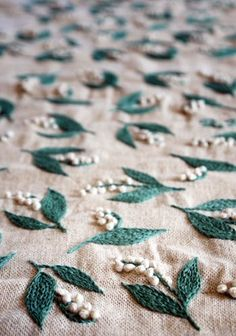 Lily of the Valley pattern by embroidery artist Yumiko Higuchi. Could make a nice border on a skirt or dress?...