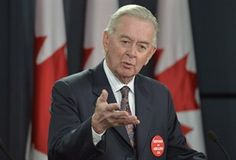 Preston Manning, former Leader of the Reform Party and CEO of the Manning Foundation Preston Manning speaks during a news conference Wednesday January 22, 2014 in Ottawa. The least costly, most efficient and effective way to reduce Canadian greenhouse gas emissions is by putting a price on carbon ??? and the provinces are best situated to make the move, says a blue-chip panel of Canadian economists which includes Manning.THE CANADIAN PRESS/Adrian Wyld