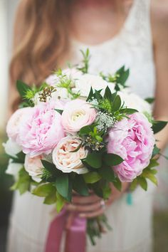 pretty pink bouquet featuring peonies, ranunculus and garden roses by Academy Florist
