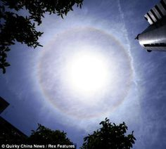 Stunning sight: A rare solar halo in the sky above Huangshan city, Anhui Province, in China. The effect is created when the sun shines through hexagonal crystals in high-altitude cirrus clouds