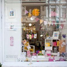 our lovely shopwindow 💛#die_buntique #diebuntique #buntique #store #shopwindow #handmade #design #colorful #madeinvienna #vonhandmitherz  #children #toy #papeterie # print #cats #shoplocal #kirchengasse26 #vienna