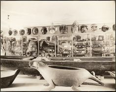 """View of exhibits in the Museum of the American Indian/Heye Foundation, Second Floor, West Hall, """"Ethnology of California, the Northwest and the Desert Southwest."""" A very large Kwakwaka'wakw feast dish in the form of a bear (068742.000) is in the foreground 1921"""