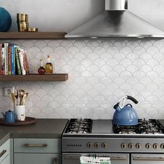 white tile mirror with fish scale tiles in modern kitchen - White Kitchen Remodel Kitchen Fan, Kitchen Backsplash, Kitchen Decor, Kitchen Design, Kitchen Cabinets, Black Wall Tiles, White Tiles, Scallop Tiles, Mermaid Tile
