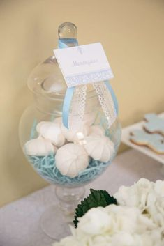 Meringues in glass jars at a Baby blue with lace Baptism Party!  See more party planning ideas at CatchMyParty.com!