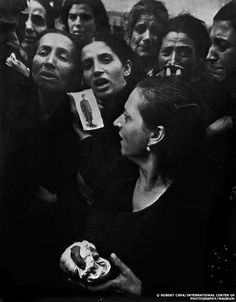Robert Capa. The funeral of 20 teenagers who were partisans fighting against the German occupying forces, killed four days before the liberation of Naples.