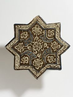 Tile Place of origin: Kashan, Iran (made) Date: early 14th century (made) Artist/Maker: unknown (production) Materials and Techniques: Fritware, glazed and painted in cobalt blue and lustre Museum number: 1828B-1876