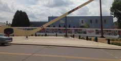 World's largest free standing hockey stick and puck with the wide format graphics printed and installed by Catapult, in Eveleth, MN.