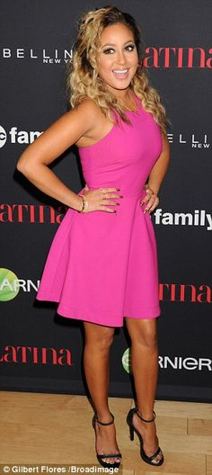 Pretty in pink: Adrienne Bailon stunned in a bright pink dress which she paired with black...
