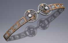 "Masriera diadem: ""This extremely refined bracelet/tiara was made by Luís Masriera of Barcelona, Spain, around 1901-1910. It is made of yellow gold and platinum, set with 513 old cut diamond brilliants with a total weight of approximately 12.5 carats. The birds' wings are decorated with plique-à-jour enamel. The birds are set with two important diamonds of about 1.2 carats each. This magnificent piece can be worn either as a bracelet or as a tiara.""  Via A. Aardewerk Jewelers."