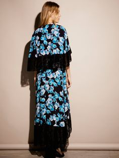Midnight Garden Cape Maxi | Printed floral maxi featuring an elegant, romantic cape with lovely lacey details. Wrapped design with dramatic front slit.