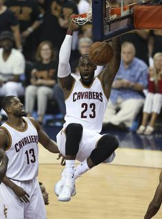 Cleveland Cavaliers forward LeBron James (23) dunks against the Golden State Warriors during the first half of Game 6 of basketball's NBA Finals in Cleveland, Thursday, June 16, 2016. (AP Photo/Ron Schwane)
