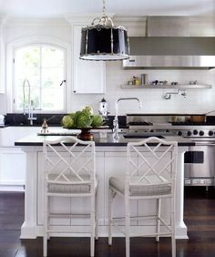 Elegant but casual kitchen with light walls and cabinets, dark counters and floors