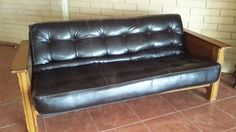 This is quite a mid century style futon sofa bed package. Unfortunately it is discontinued. However, if you follow the link, you will see similar faux leather futon mattress like this one.