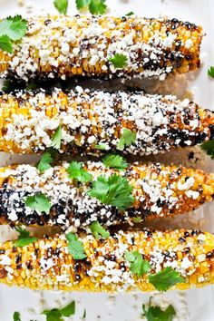 mexican grilled corn with bacon butter and cotija cheese I http://howsweeteats.com