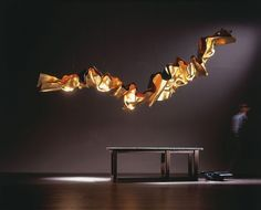 """Ingo Maurer has a fascination with light. Since the Ingo and his team have designed more than 150 lights and lighting systems. Initially inspired by  he is often referred to as the """"Poet of Light. Gaudi, Lighting Concepts, Lighting Design, Wall Sculptures, Sculpture Art, Abstract Sculpture, Bronze Sculpture, Ceiling Lamp, Ceiling Lights"""