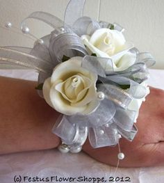 white silk rose wrist corsage with silver and pearl accents