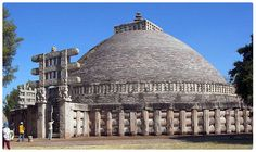 The Great Stupa at Sanchi. First constructed during Asoka's reign, it was enlarged in the middle of the 2nd century BCE. The stupa is is the greatest Buddhist monument in India. Sanchi is a small village in Raisen District of the state of Madhya Pradesh. Its nucleus was a simple hemispherical brick structure built over the relics of the Buddha. It was crowned by the chatra, a parasol-like structure symbolising high rank, which was intended to honour and shelter the relics.